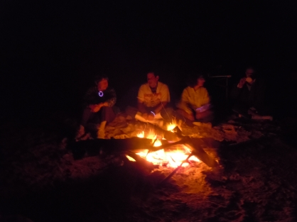 Sitting around the campfire.